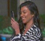 мем Девушка улыбается, смотря в смартфон